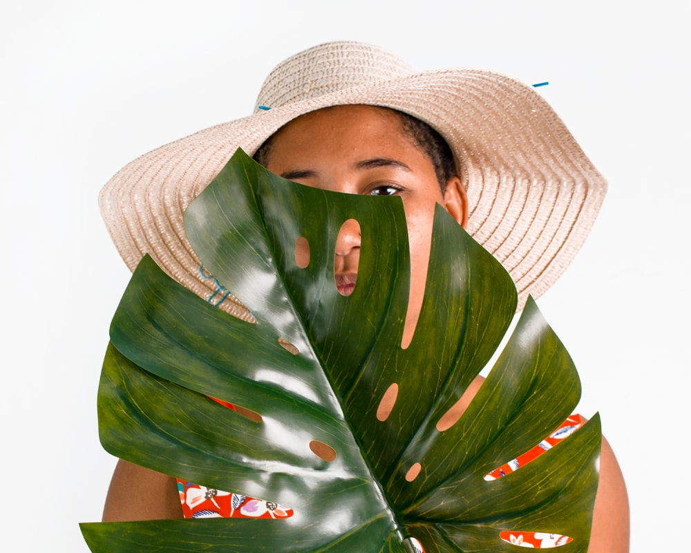 A woman hidden behind a plant much like the subconscious is hidden. The power of the subconscious mind is amazing. The subconscious mind has the power to heal and solve all of life's problems. Here is how your mind can help. #unconscious The subconscious mind can be reprogrammed to change your life.